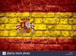 The Spain Flag Flag Of Spain Or Spanish Banner On Brick Texture Stock Photo