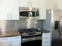 white kitchen cabinets with stainless steel backsplash metal silver stainless steel 3 8x4 stick brick tile