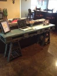 chalkboard wall office space with sawhorse desk desks men cave