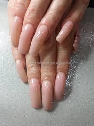 pink slushie gel polish over natural nail acrylic overlays nails