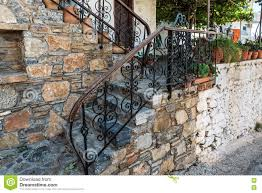 traditional greek vintage stairs with beautiful handrails stock