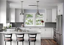 white kitchen subway tile backsplash gray island with marble countertop white tile backsplash stainless