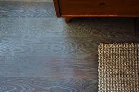 turn your wood floors gray floor weathered look bob vila