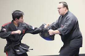 Martial arts studio owner reflects on his journey pays it forward