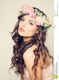 beautiful young woman with flowers long curly hair stock photo