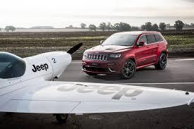 jeep grand cherokee srt jeep grand cherokee srt battles plane in a lap