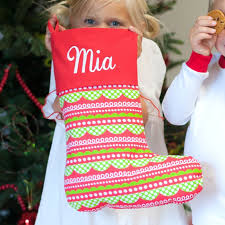 personalized red and green patterned christmas stockings