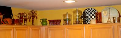 Decorating Ideas For Above Kitchen Cabinets Decorating Above Kitchen Cabinets
