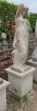 cast garden statue of a classic figure on plinth