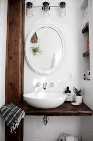 over the toilet shelf white shine modern glass door bath stainless bathroom white varnished wooden vanity cabinet round stainless steel frame recessed light lamp deluxe rectangular black
