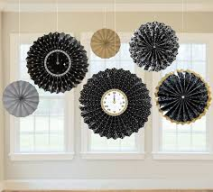 hanging paper fans just wait until the clock strikes midnight clocks