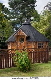 Garden Summer Houses Scotland - hexagonal wooden felted garden shed at deeside log cabins stock