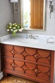 how to clean wood cabinets in bathroom decorative bathroom vanity in a medium brown finish
