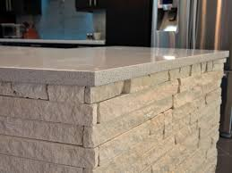 stone island kitchen a stacked stone island adds texture to the sleek kitchen each