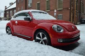 red volkswagen convertible 2013 volkswagen beetle turbo convertible four seasons update