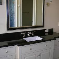 Absolute Black Granite Design Ideas - Black granite with white cabinets in bathroom