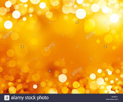 festive sparkling lights shiny gold background in sparkles stock
