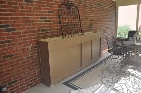 ballard designs outlet meets craigslist potting bench evolution in case you re wondering yes that appears to be scribbling with chalk on my porch wall i have an artistic 4 year old girl what can i say