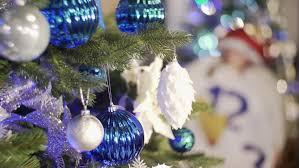 gold christmas ball on christmas tree new year decoration stock