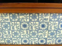 interior blue tile backsplash and brown wooden kitchen cabinet
