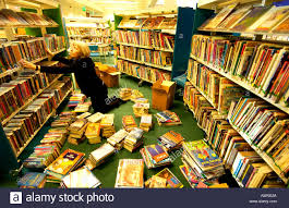 Awn Books A Woman Librarian Sorting Children U0027s Books In Inspiring Solar