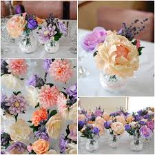 paper flower centerpieces wedding centerpiece lace decorated carafes and lovely paper