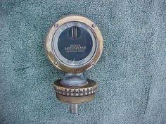 antique ford radiator cap with ornament brass wings