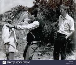 Desi Arnes by 1968 Richard Thomas And Catherine Bums Watch Anxiously As Desi