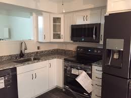 pictures of white kitchen cabinets with black stainless appliances tiny kitchen remodel kitchen doctors custom kitchen