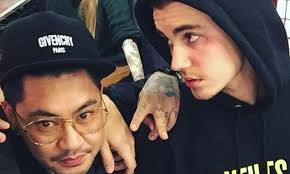 justin bieber s artist reveals meaning inking of