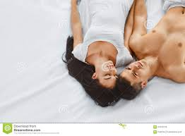 Lovely Couple In Bed Lying In Bedroom Happy Couple In Bed Stock Photo Image Of Love Bedroom 61074720