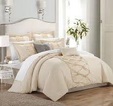 bedroom enchanting white ruffle comforter for bedroom decoration beige and white ruffle comforter with wooden floor and area rug for bedroom decoration ideas