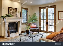 great room fireplace french doors stock photo 37655704 shutterstock