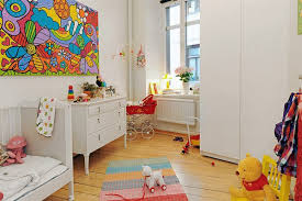 colroful world map image painted white wall playroom ideas