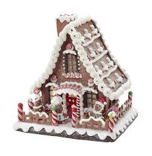 lighted gingerbread house with and decorations