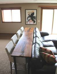 Cheap Ways To Keep Stuff Organized In Your TinyAss Apartment - Dining room table with sofa seating