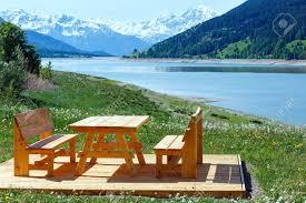 Landscape Timber Bench Reschensee Or Lake Reschen Summer Landscape With Blossoming