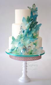 wedding cake with a cascade of wafer paper butterflies all hand