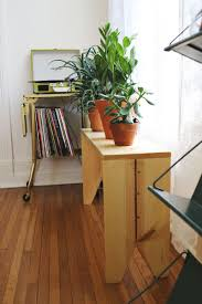 diy bench perfect for plants in the front hall window on the