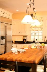 butcher block dining table kitchen traditional with black cabinets