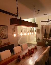 wood beam light fixture reclaimed wood beam chandelier with edison globe lights fama creations