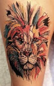 watercolor lion head tattoo on thigh