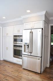 gray kitchen cabinets with white crown molding crown moulding soffit disguise ge cafe appliances wall