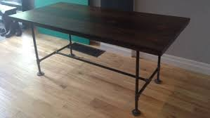 wood and pipe table build industrial furniture with wood and pipes lifehacker australia