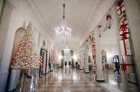 white house decorated with gingerbread houses giant douglas fir
