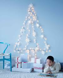 lights on wall with pictures string light wall tree with felt star ornaments martha stewart