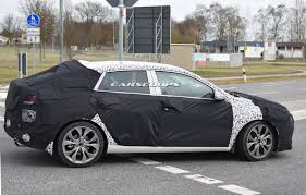 hyundai spied testing new coupe style i30 fastback