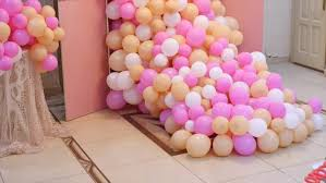 decoration of colorful pinky flying ballons made for a wedding