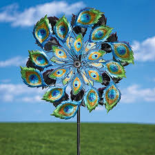 magnificent peacock solar wind spinner solar multi color kinetic