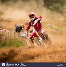 motocross race track motocross rider in race on dusty race track stock photo royalty